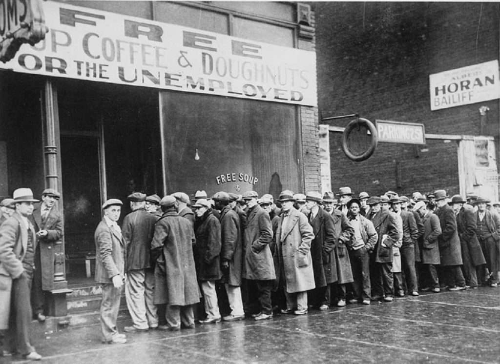 Men stand in line outside a depression soup kitchen, 1931. NARA